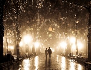 Couple walking at alley in night lights. Photo in vintage multic