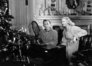 "Bing Crosby and Marjorie Reynolds in the scene from ""Holiday Inn"" in which they sing ""White Christmas"""