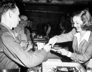 Bette Davis serves a serviceman at the Hollywood Canteen