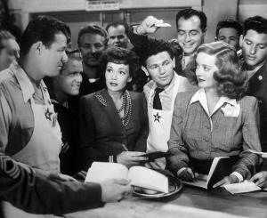 Jack Carson, Jane Wyman, John Garfield, and Bette Davis in a scene from Hollywood Canteen