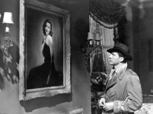 Detective Mark McPherson (Dana Andrews) gazes at the portrait of Laura Hunt (Gene Tierney) in a scene from the film Laura